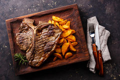 Medium rare Grilled T-Bone Steak with potato wedges Stock Image