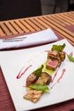 Medium rare lamb roasted decorated dish Royalty Free Stock Images