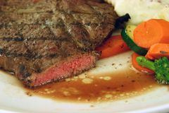 Medium rare steak. And vegetable royalty free stock photo