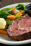 Medium rare steak. With au jus and steamed vegetables stock images