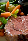 Medium rare steak. With au jus and steamed vegetables royalty free stock image