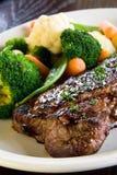 Medium rare steak. With steamed vegetables stock image