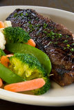 Medium rare steak. With steamed vegetables royalty free stock photo