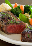 Medium rare steak. With steamed vegetables royalty free stock photos