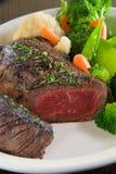 Medium rare steak. With steamed vegetables stock photo