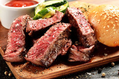 Medium Rare Steak burger on wooden board, selected focus stock photography
