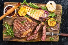 Medium rare steak grilled, top view on board.  stock images