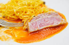Medium rare tuna fish and fresh Tagliatini Royalty Free Stock Photo