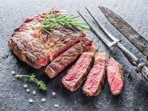 Medium Ribeye steak. Stock Photos