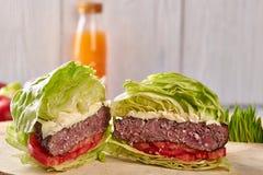 Medium roast beef hamburger with salad, without buns royalty free stock image