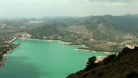Medium shoot from above of water reservoir `Embalse de Amadorio` in Orxeta, Spain. stock video