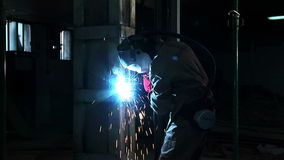 Medium shoot of craftsman and welding arc stock footage