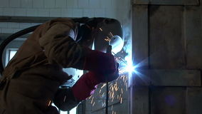 Medium shoot of craftsman welding stock footage