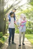 Medium shot of asian muslim family having a good time Royalty Free Stock Image