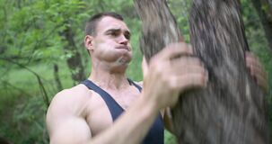 Athletic man working out with log
