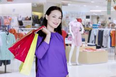 Medium shot of caucasian woman with paper bag in a mall Stock Photography