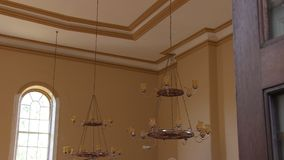 A shot of a chandelier in a house. A medium shot of a chandelier. Camera slides in and out stock video footage