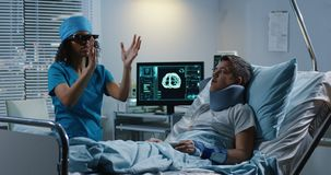 Doctor using VR headset during discussing diagnosis. Medium shot of Doctor using VR headset during discussing diagnosis stock images