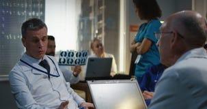 Doctors having a meeting. Medium shot of doctors talking during a meeting stock footage