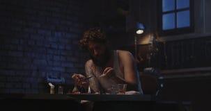 Man heating drug in a spoon. Medium shot of a drug addict smoking while heating drug in a spoon stock video