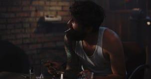 Man heating drug in a spoon. Medium shot of a drug addict smoking while heating drug in a spoon stock video footage
