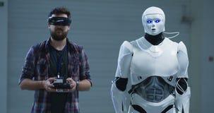 Engineer controlling robots hand movement