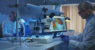 Biologist looking at camera