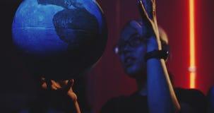 Young teacher teaching astronomy with planet models. Medium shot of a female teacher explaining astronomy to students with suspended planet models stock video