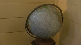 A globe cartograph shot. A medium shot of a globe cartograph. Camera tilts down and tilts up stock footage