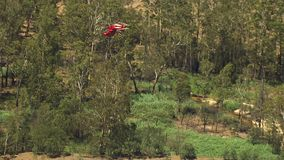 Helicopter and trees. A medium shot of a helictopter and trees. Camera zooms in stock video footage