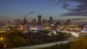 A medium shot of highway interchange traffic in front of downtown St. Paul during a Fall Sunset. An autumn twilight timelapse of traffic passing the downtown St stock footage
