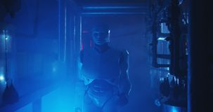 Humanoid robot working in a smoke filled lab. Medium shot of a humanoid robot checking a gauge in a smoke filled lab royalty free stock photos