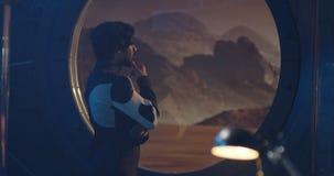 Astronauts talking by Martian base window