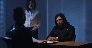 Investigators interrogating a criminal royalty free stock image