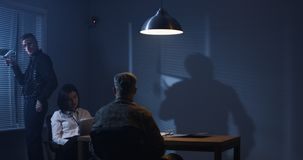 Investigators interrogating a soldier royalty free stock image
