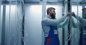 Male technicians working in a data center stock image