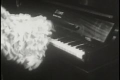 Medium shot of man in costume playing piano stock footage