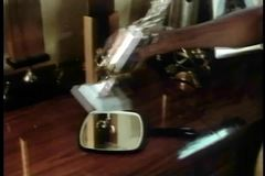 Medium shot of man picking up hand mirror on trophy table stock video