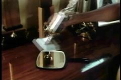 Medium shot of man picking up hand mirror on trophy table stock video footage