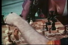 Medium shot of man and woman playing chess stock footage