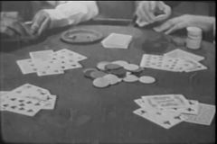 Medium shot of men playing card game stock video footage
