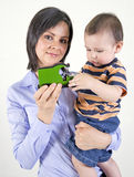 Mum and her young son playing with a toy car Royalty Free Stock Images