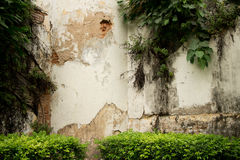 Medium shot of old corner guard tower at colonial era prison in. Southeast Asia; numerous forms of tropical vegetation are visible. This architectural detail Stock Image