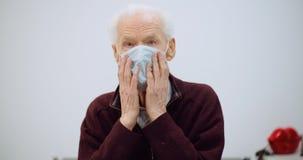 Old man wearing mask against coronavirus