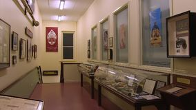 Paintings and displays on walls. A medium shot of paintings and display on walls. Camera pans to the right stock video
