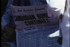Medium shot of person reading newspaper on cable car stock footage