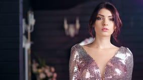 Medium shot portrait of beautiful Hispanic young female model defile at luxury background stock footage