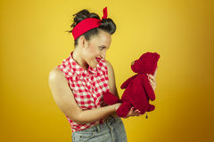 Medium shot portrait beautiful pin up with cute red teddy bear Stock Photography