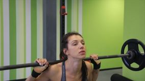 Medium shot slow mo tilt-down tilt-up men and women exercising and lifting weights female bodybuilder champion athlete. Doing power clean in cross fit gym stock video