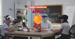 Students learning Chinese with a VR learning app. Medium shot of a students learning fruit names in a Chinese language class with a VR learning app stock video
